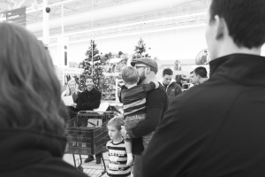 Shoppin' it out: Brad Holmes, pastor for Union at Ada Bible Church preps his group to head into the aisles of Meijer to shop. This group helped sponsor several CSPS families in need this Christmas.