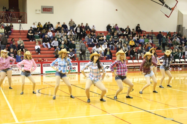 """Country Girl (Shake It For Me)"": The dance team shakes their hips to songs by Luke Bryan, Carrie Underwood, and Miranda Lambert.  Not all the girls on the team were present in the dance.  Photo by Hannah Wight"