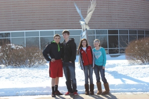 Incoming freshmen: (From left to right) Collin Alvesteffer '17, Troy Patin '17, Lindsay Lehman '17, and Kaitlyn Coons '17 pose together in front of the hawk outside of the high school. The incoming freshman enjoyed the orientation.