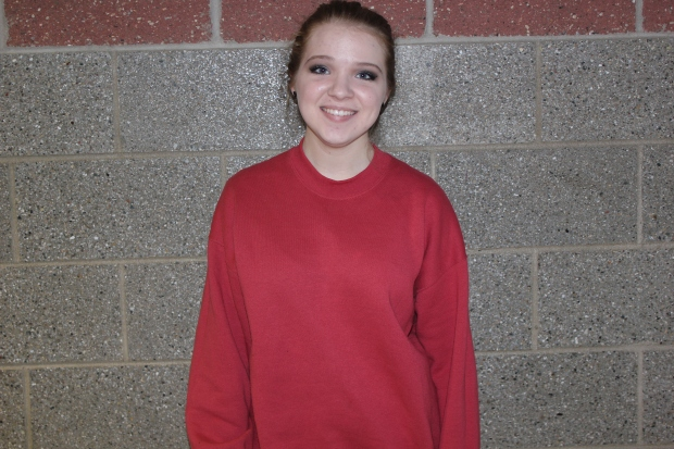 Crew neck class day: Elaina Sagorski '15 shows off her class spirit. Her red sweater was a great choice.